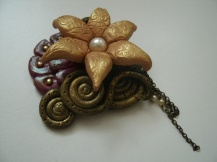 Golden flower brooch